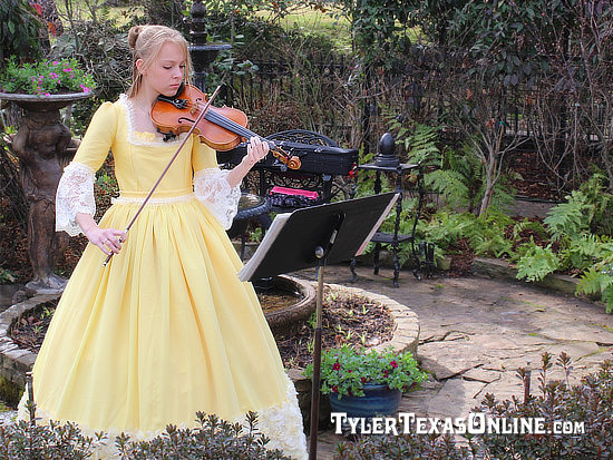 Young violin player entertaining the crowd at the opening of the 2014 Tyler Azalea Trails, March 21, 2014