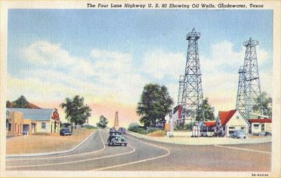 The four lane highway U.S. 80 showing oil wells, Gladewater, Texas